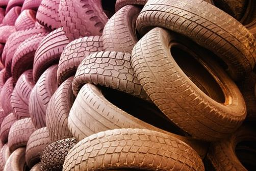 Pile of old tyres, Making tyres from microbes and plants, AIBN's  Small Things Big Changes