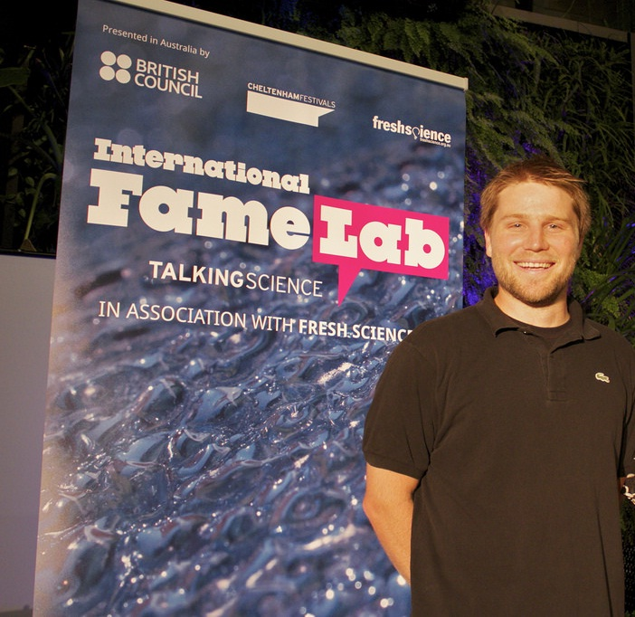PhD student Tim Brennan presenting his innovative research at 2014 FameLab Australia