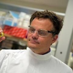 Professor Mark Kendall holding a Nanopatch.