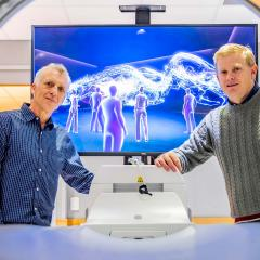 Robert Parton and Kristofer Thurecht in front of VR image